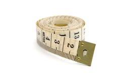 Nastro di misurazione rotolato isolato Fotografia Stock Libera da Diritti