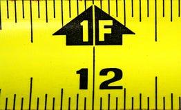 Nastro di misurazione un piede Fotografia Stock Libera da Diritti