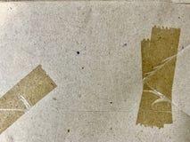 Nastro di plastica su carta marrone fotografia stock libera da diritti