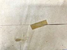 Nastro di plastica su carta marrone fotografia stock