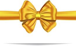 Nastro dorato del regalo con l'arco Fotografie Stock