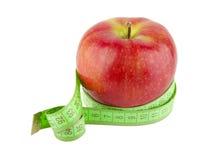 Nastro e mela di misurazione fotografia stock