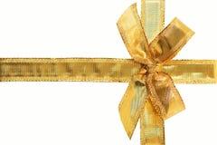Nastro ed arco dorati del regalo Fotografia Stock Libera da Diritti