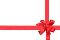Nastro ed arco rossi del regalo sul backgrou bianco Fotografie Stock Libere da Diritti