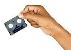 Nastro magnetico con la mano immagini stock