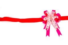 Nastro rosa dell'arco su fondo bianco Immagine Stock