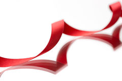 Nastro rosso del bello tessuto su bianco Immagine Stock Libera da Diritti