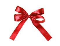 Nastro rosso ed arco del tessuto isolati su un fondo bianco Fotografie Stock