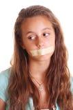 Nastro sulla bocca della ragazza Fotografie Stock Libere da Diritti
