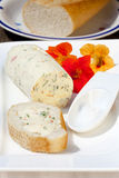 Nasturtium herb butter on baguette Royalty Free Stock Photo