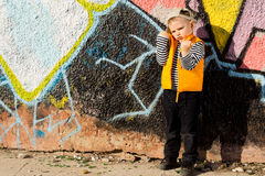 Nasty angry little girl outside showing fists Royalty Free Stock Photos