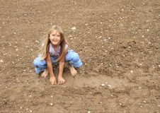 Nasty girl playing in mud Royalty Free Stock Images