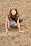 Nasty girl playing in mud Stock Images