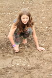 Nasty girl playing in mud Stock Photos