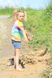 Nasty girl standing in mud Stock Photo