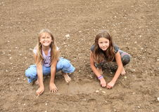 Nasty girls playing in mud Stock Images