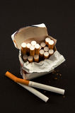 Nasty  open pack cigarettes Stock Image