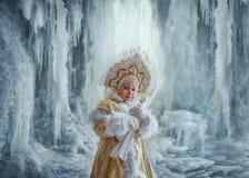 Nastya in a gold kokoshnik and fur coat.