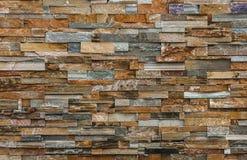 Natürliche bunte Steinwand Stockfotografie