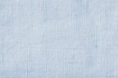 Natürliche hellblaue Flachs-Faser-Leinenstruktur, ausführliche Nahaufnahme, rustikale zerknitterte Weinlese maserte Gewebeleinwan stockfotos