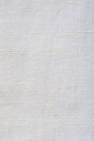 Natürliche helle weiße Flachs-Faser-Leinenstruktur führte Makronahaufnahmerustikales zerknittertes Weinlese Texturgewebeleinwand- Lizenzfreie Stockfotografie