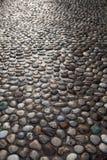 Natürliche runde Steinbodenbeschaffenheit - Hintergrund lizenzfreies stockfoto