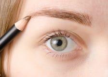Natürlicher Augenbrauenstift des weiblichen Auges Lizenzfreie Stockfotos