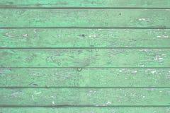 Natürlicher hölzerner Hintergrund Alt malte in den grünen Brettern stockfotografie