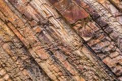 Natürlicher Hintergrund - Rot abgestreifte Felsenbeschaffenheit Lizenzfreie Stockbilder