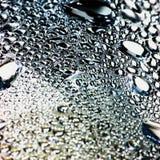 Natürlicher unscharfer Tautropfen-Luftblasenmakrohintergrund Stockbild