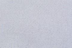 Natürliches weißes Leinengewebe mit glänzenden Scheinen Stockbilder