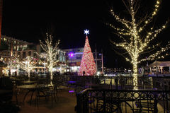 Nat'l Harbor Holiday Tree Washington DC at Night. Many tourists and local residents visit the National Harbor Waterfront for a dazzling display of lights on the Royalty Free Stock Photo