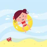 Natação de sorriso bonito da menina no mar Foto de Stock