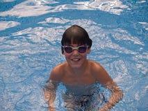 Natación del muchacho Foto de archivo libre de regalías
