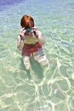 Natación del muchacho en el océano Imágenes de archivo libres de regalías