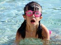 Natación de la chica joven en el mar Foto de archivo libre de regalías