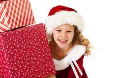 Natal: Auges da menina dos presentes de trás fotografia de stock royalty free
