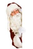 Natal: Cartão de sorriso do branco de Santa Looks Out From Behind fotos de stock royalty free