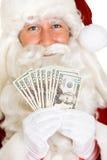 Natal: Dinheiro de Santa Claus Holds Fanned Out E.U. foto de stock