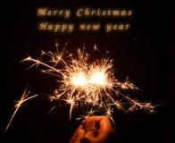 Natal e chuveirinho newyear do partido no preto Imagem de Stock Royalty Free