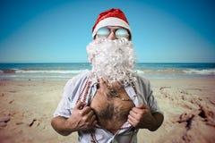 Natal engraçado do verão da praia do super-herói de Papai Noel Fotos de Stock