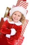 Natal: A menina em Front Of Large Stack Of envolveu presentes imagens de stock
