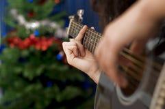 Natal que Carolling Imagens de Stock