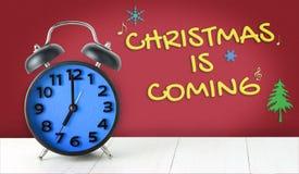Natal que vem com despertador azul Fotos de Stock