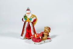 Natal Santa Claus com uma vela do Natal Imagem de Stock