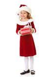 Natal: Santa Girl Holds Christmas Gift foto de stock royalty free