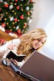 Natal: Tomando notas no presente em linha Fotos de Stock