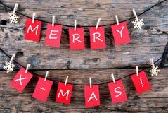 Natale allegro sulle etichette rosse Fotografia Stock Libera da Diritti