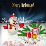 Natale astratto che accoglie con la siluetta della città Immagini Stock