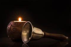 Natale Bell e candela Fotografia Stock Libera da Diritti